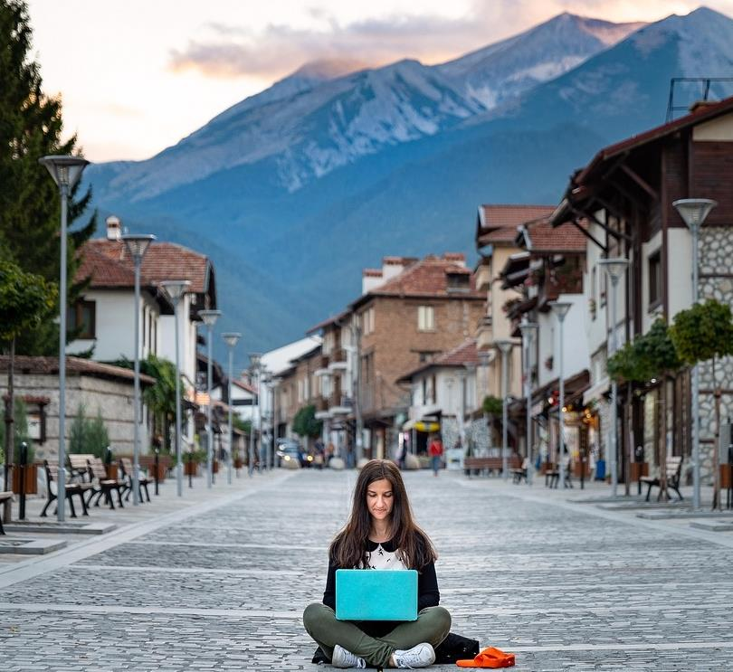 A woman working remotely in a hilly area
